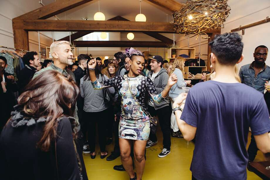 Stylist Charlize Antoinette turns the store into an impromptu dance floor. Photo: Alternative