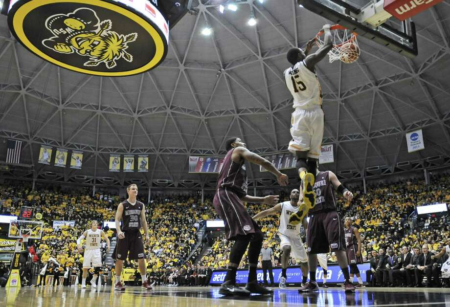 Wichita State's Nick Wiggins dunks on Missouri State as the Shockers cap a 31-0 regular season, becoming the first since Saint Joseph's (2004) to enter its conference tournament unbeaten. Photo: Peter Aiken, Getty Images / 2014 Getty Images