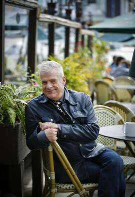 Program director Marc Huestis, seen on Thursday, Feb. 27, 2014 in San Francisco, Calif., says he likes the flower boxes at Cafe Flore because he can feel the friends he lost to AIDS in the 80s.