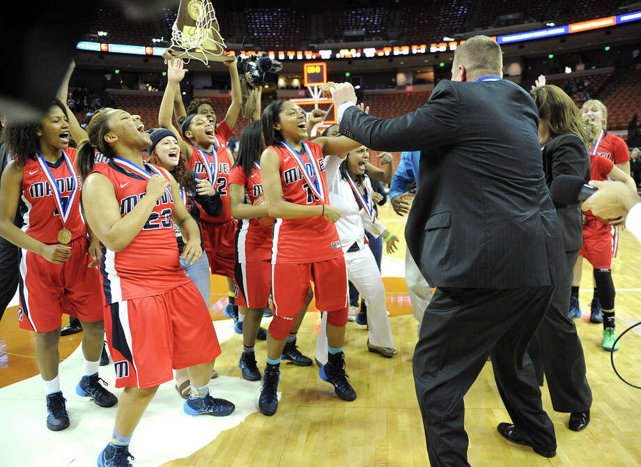 Manvel collects the medals and trophy that go with winning a state title. Photo: Ashley Landis, Photographer / ©Ashley Landis