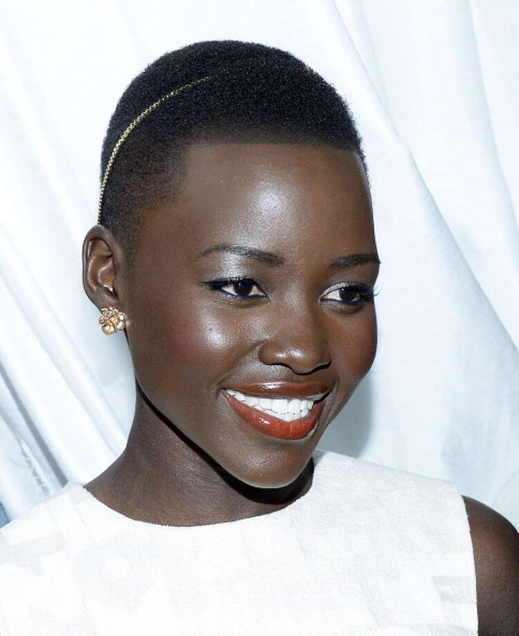 "Lupita Nyong'o won best actress for experiencing the depths of hell as an abused slave in Steve McQueen's ""12 Years a Slave."" Photo: Kevork Djansezian, Getty Images / 2014 Getty Images"