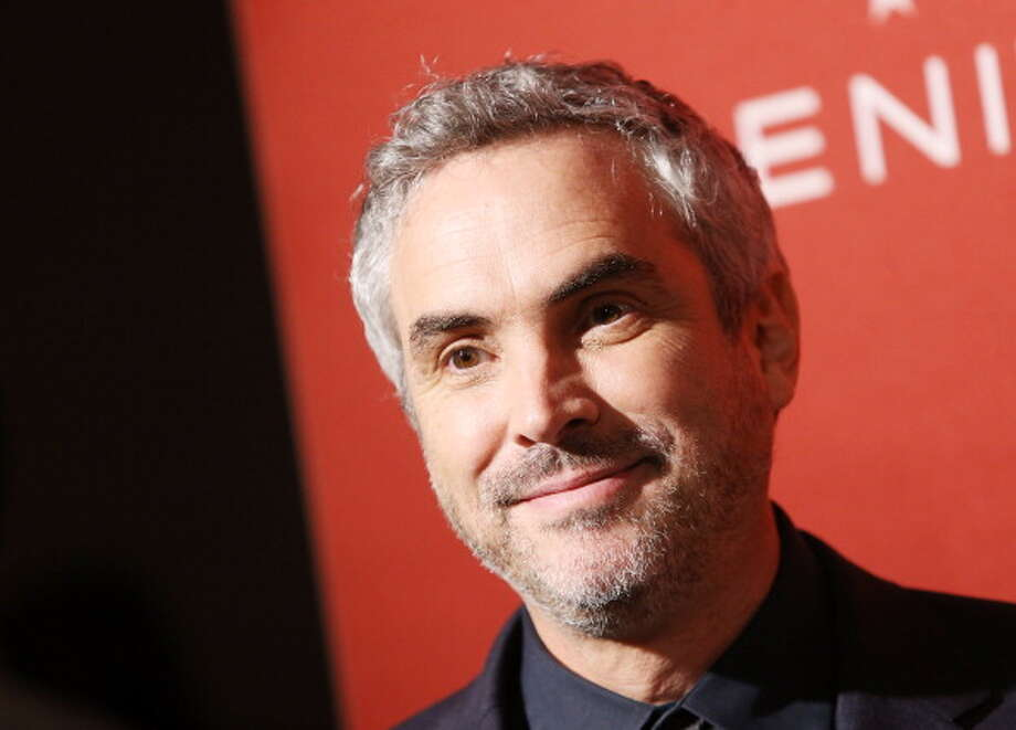 """""""12 Years a Slave,"""" British director Steve McQueen's groundbreaking, fact-based saga of a free man who was entrapped and enslaved, won best picture at Sunday night's Academy Awards celebration.  In a split decision,  best director was won by Alfonso Cuaron, the creator of """"Gravity."""" Photo: Michael Tran, FilmMagic / 2014 Michael Tran"""
