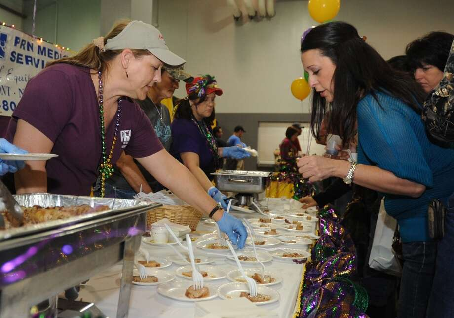 Celia Burleson looks over Courville's offerings during the Taste of the Triangle event at Ford Park on Tuesday. Photo taken Tuesday, February 12, 2013  Guiseppe Barranco/The Enterprise Photo: Guiseppe Barranco/The Enterprise