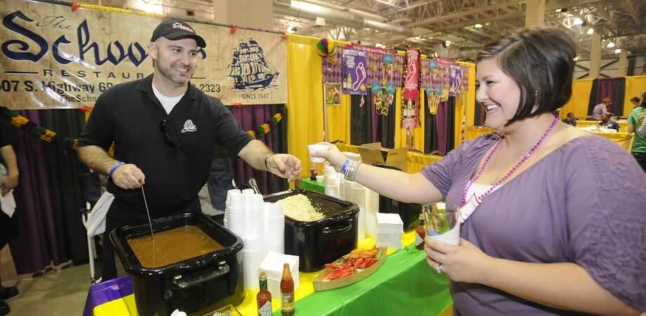 The Schooner Restaurant was new to the event this year with George Megas, left, serving up shrimp gumbo to Jessica Tubbs of Beaumont.  The annual Taste of the Triangle was held at the Ford Exhibit Hall at Ford Park.  It  featured food booths from all over the area, from country and soul foods, to Tai, Italian, Cajun and Creole foods. This was the 29th annual event put on by the Sabine Area Restaurant Association.    Dave Ryan/The Enterprise Photo: Dave Ryan/The Enterprise
