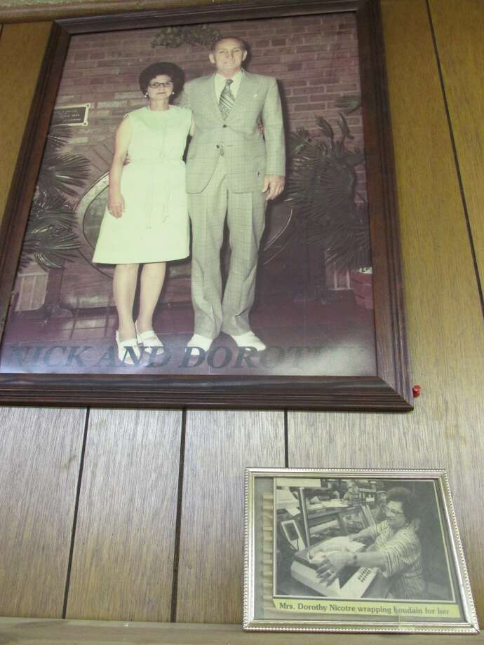 Nick and Dorothy Nicotre, founders of Nick s Grocery, still look down over the Port Arthur specialty grocery store. Photo: Cat5
