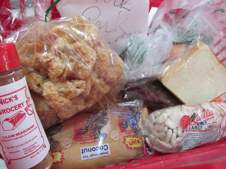 A well stocked basket at Nick s Grocery - don t forget the Cajun seasoning. Photo: Cat5