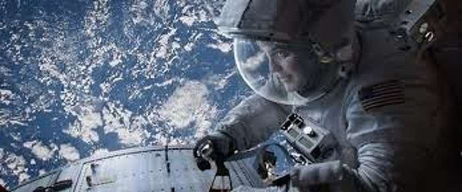 """The visually stunning """"Gravity"""" was the big winner at the Academy Awards Sunday night, picking up ---- awards, including best picture and a best director award for Alfonso Cuaron.  The 3-D film, set in outer space, also won a host of awards in the technical categories."""