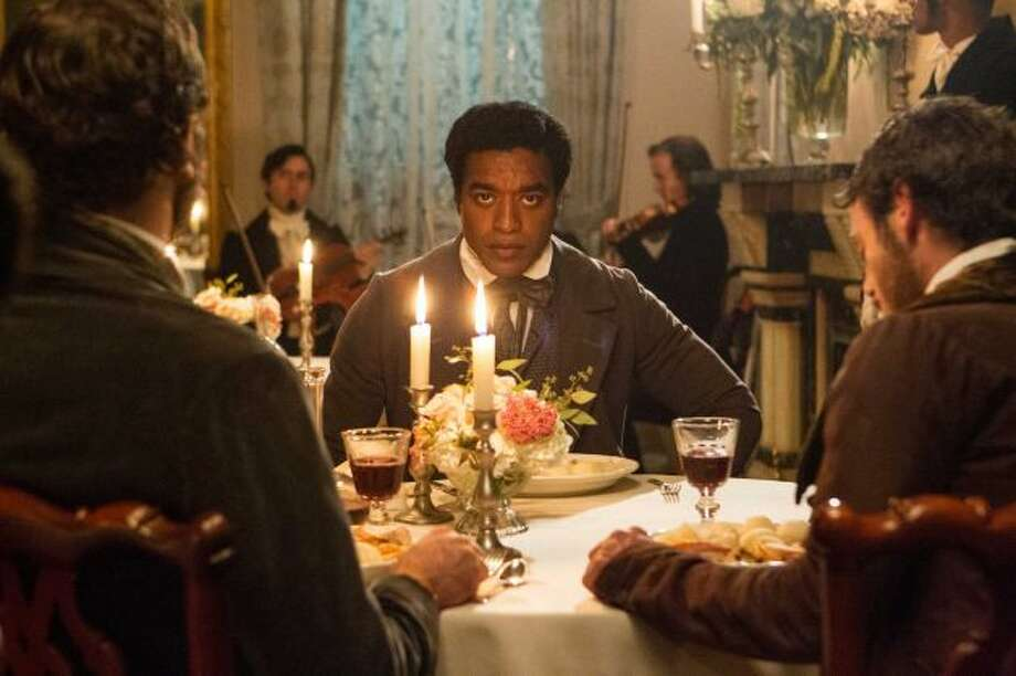"""12 Years a Slave,"" British director Steve McQueen's groundbreaking, fact-based saga of a free man who was entrapped and enslaved, won best picture at Sunday night's Academy Awards celebration.  It was the evening's big winner, picking up best director and ----"