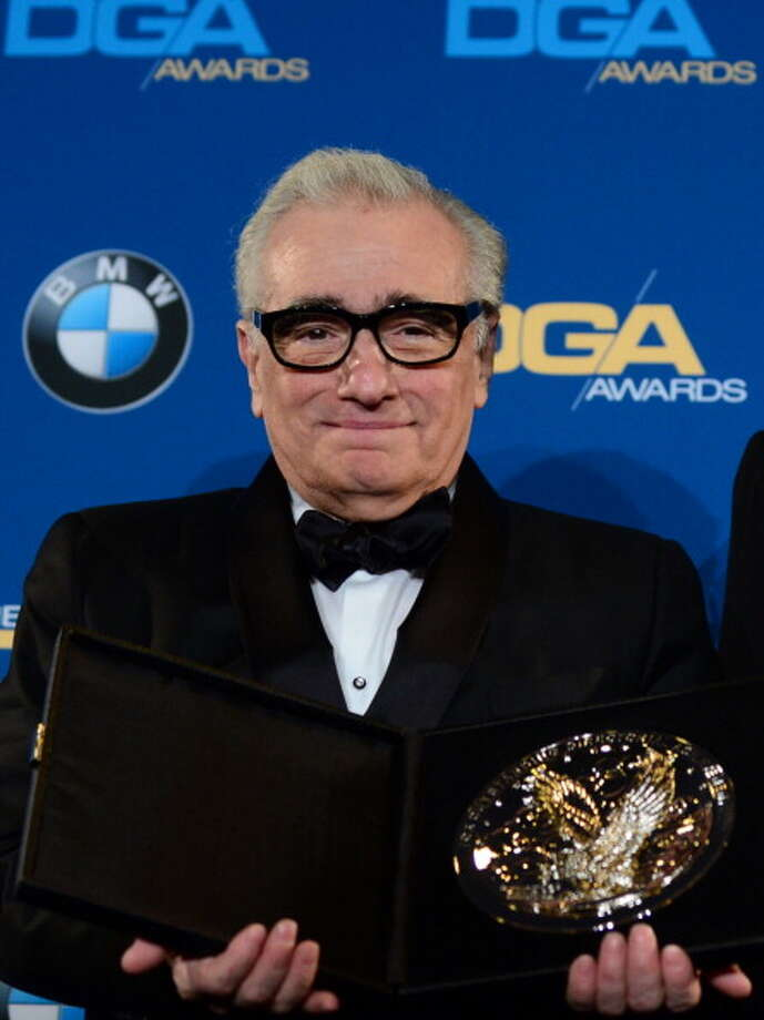 "In a jawdropping upset sure to keep Oscar enthusiasts talking for years, ""The Wolf of Wall Street,"" Martin Scorsese's profane and caustic fact-based comedy about the life and career of a ruthless Wall Street predator, was the unexpected big winner Sunday night, picking up ---- awards, including best picture, ---- and -----. s Photo: FREDERIC J. BROWN, AFP/Getty Images / 2014 AFP"