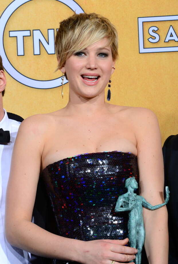 "Jennifer Lawrence won supporting actress for her role as the trashy wife of a New York con man in ""American Hustle.""  It was her second consecutive Oscar -- she won best actress last year for ""Silver Linings Playbook,"" working with the same director.  This might be the first time in Oscar history in which an actor has won back to back Oscars for films by the same director. Photo: Ethan Miller, Getty Images / 2014 Getty Images"