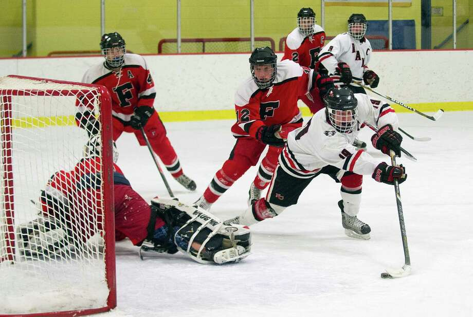 New Canaan's Henry Stanton scores a goal during Friday's FCIAC quarterfinals against Fairfield at Terry Conners Rink in Stamford, Conn., on February 28, 2014. Photo: Lindsay Perry / Stamford Advocate