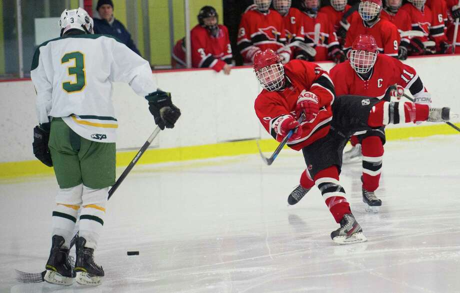 Greenwich's Tommy Rogan takes a shot during Saturday's FCIAC quarterfinal against Trinity Catholic at Terry Conners Rink in Stamford, Conn., on March 1, 2014. Photo: Lindsay Perry / Stamford Advocate