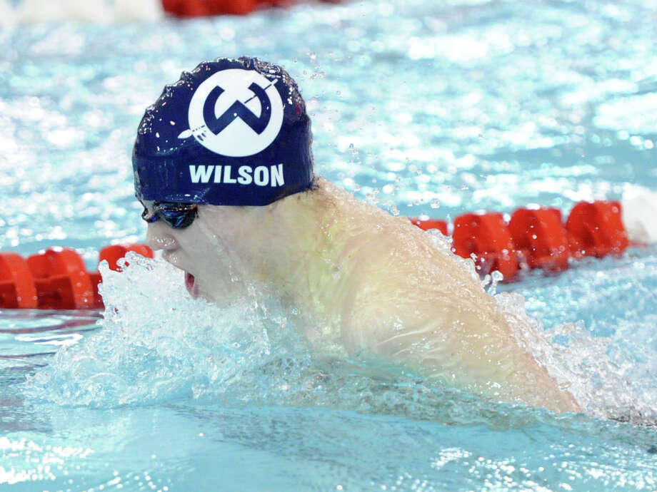 Kyle Wilson of Wilton swims the breatstroke during the 200 medley relay event FCIAC Boys Swimming Championships at Greenwich High School, Thursday night, Feb. 27, 2014. Photo: Bob Luckey / Greenwich Time