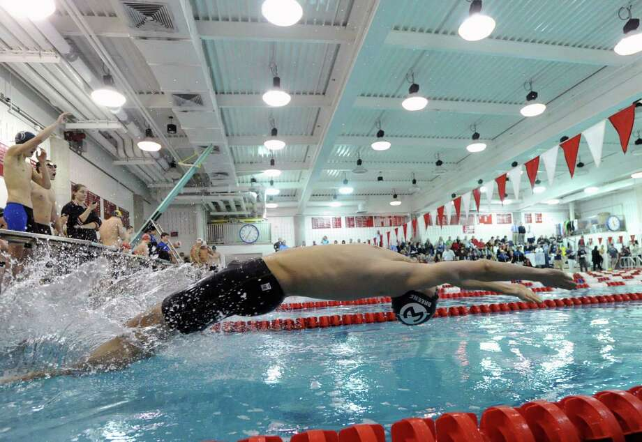 Callum Breene of Staples at the start of the 200 medley relay consolation heat during the FCIAC Boys Swimming Championships at Greenwich High School, Thursday night, Feb. 27, 2014. Photo: Bob Luckey / Greenwich Time