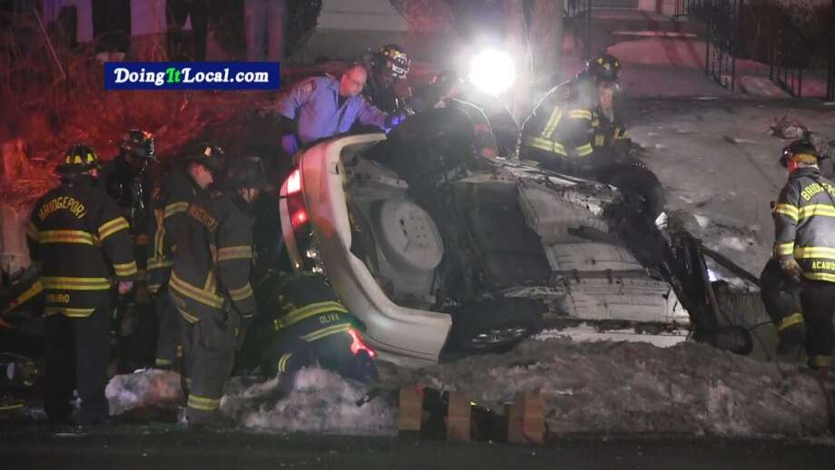 A man and a woman died and a third person was seriously injured after a crash Saturday night on Madison Avenue in Bridgeport. Photo: Steven Krauchick, DoingItLocal.com