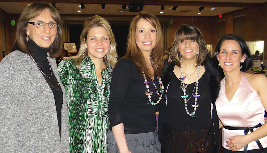 Assumption School Principal Gerrie Desio, left, and event committee members Jennifer Cullinan, Jody Gourley, Karen Guastelle and Melinda Gremse at the school's Saturday night Mardi Gras fundraiser. Photo: Mike Lauterborn / Fairfield Citizen contributed
