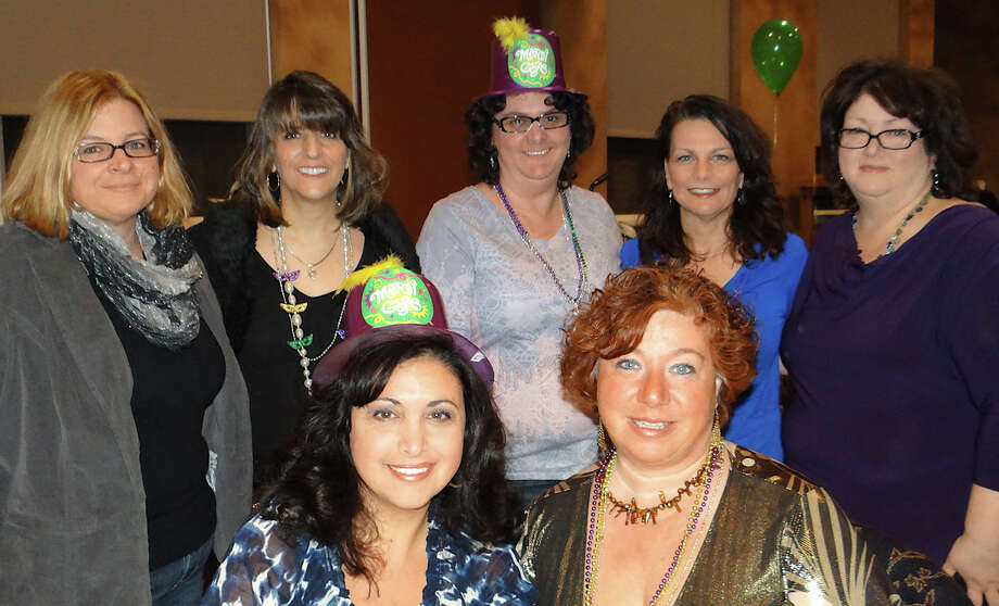 Among those who turned out at Assumption School's Mardi Gras fundraiser were, seated, Maria DiSorbo and Linda Ferranti, and Barbara Meyer, Karen Guastelle, Lisa Conroy, Diane Manderville and Debbie Bojnec. Photo: Mike Lauterborn / Fairfield Citizen contributed