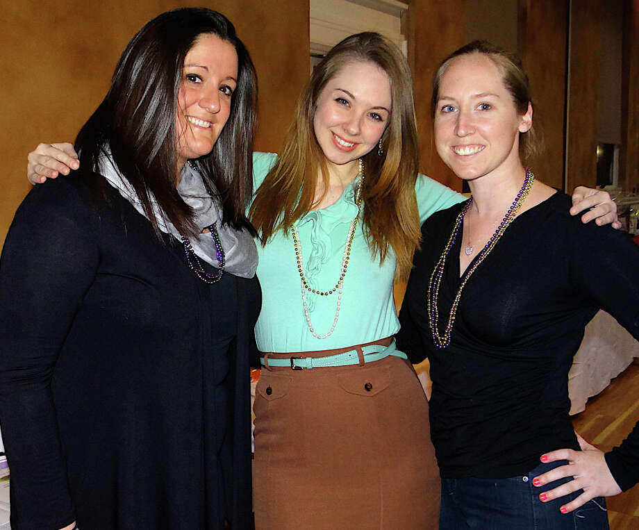 Assumption teachers Christie Vieira, Amanda Tripp and Katie Peterson at the school's Mardi Gras fundraiser Saturday evening. Photo: Mike Lauterborn / Fairfield Citizen contributed