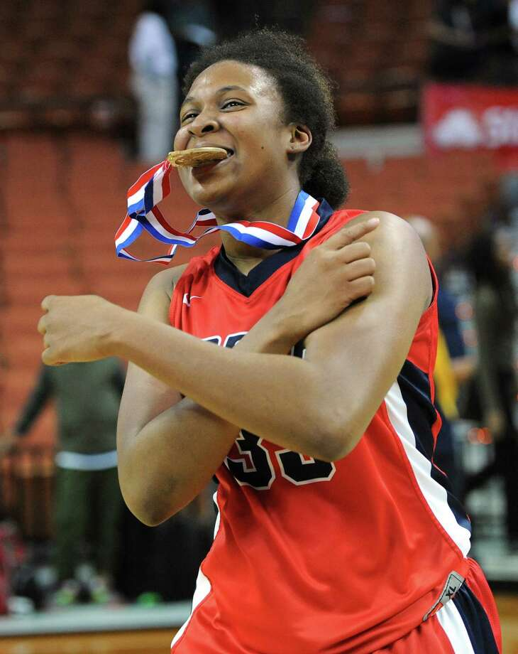 Manvel's Rangie Bessard (35) celebrates a win over Duncanville during the UIL 5A state final girls basketball game between Manvel and Duncanville high schools on Sat., March 1, 2014 at the Frank Erwin Center in Austin, TX. Photo: Ashley Landis, Special Contributor / ©Ashley Landis
