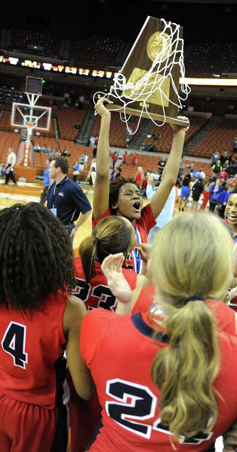 Manvel celebrates a 58-53 win over Duncanville during the UIL 5A state final girls basketball game between Manvel and Duncanville high schools on Sat., March 1, 2014 at the Frank Erwin Center in Austin, TX. Photo: Ashley Landis, Special Contributor / ©Ashley Landis