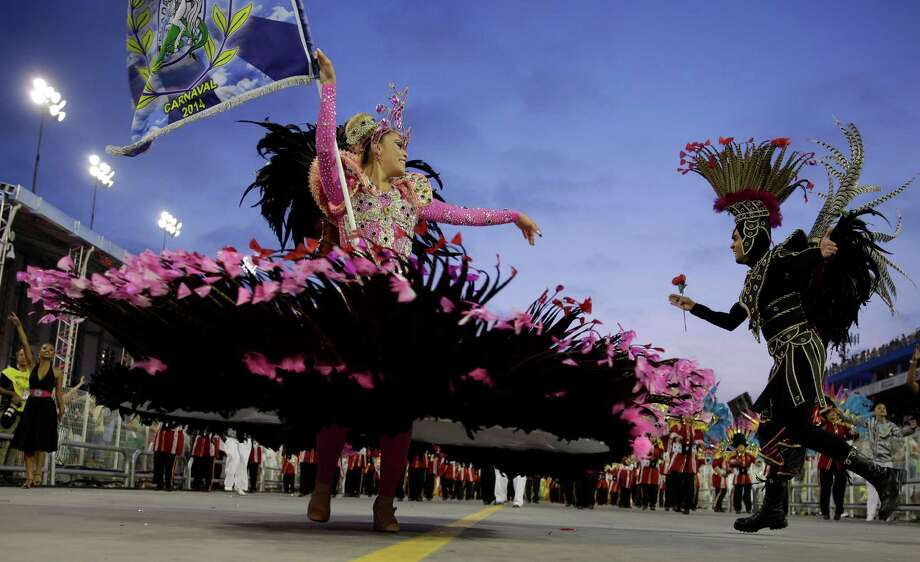 Dancers from the Academicos do Tatuape samba school perform during a carnival parade in Sao Paulo, Brazil, Sunday, March 2, 2014. Photo: Andre Penner, AP / AP