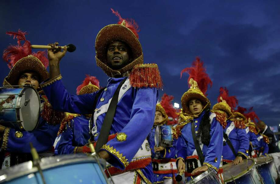 Drummers from the Academicos do Tatuape samba school perform during a carnival parade in Sao Paulo, Brazil, Sunday, March 2, 2014. Photo: Andre Penner, AP / AP