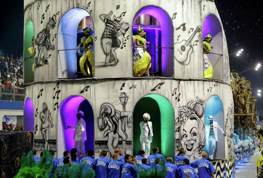 Dancers from the Aguia de Ouro samba school perform on a float during a carnival parade in Sao Paulo, Brazil, Sunday, March 2, 2014. Photo: Andre Penner, AP / AP