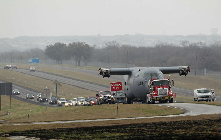 A retired C-130 Hercules cargo aircraft exit U.S. 90 West at Loop 1604 West as it is moved from Lackland Air Force Base to Camp Bullis, Sunday, March 2, 2014. The aircraft will serve as a training tool for military medics. Photo: JERRY LARA, San Antonio Express-News / © 2014 San Antonio Express-News
