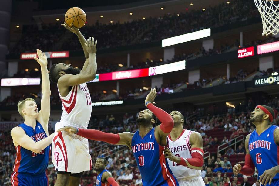Rockets shooting guard James Harden shoots over Detroit Pistons center Andre Drummond. Photo: Smiley N. Pool, Houston Chronicle