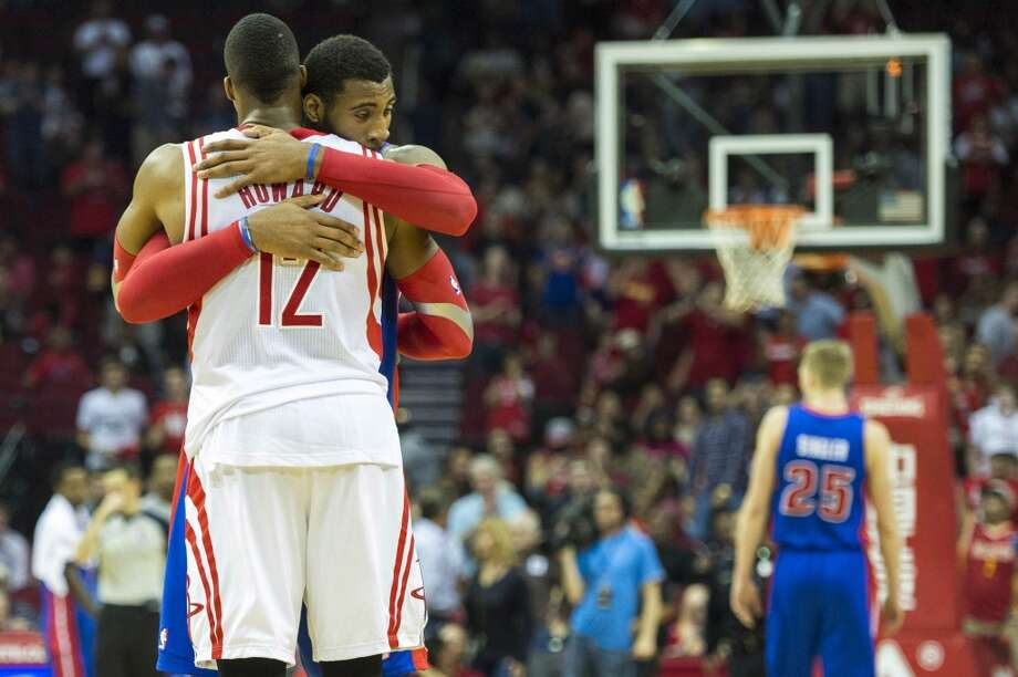 Pistons center Andre Drummond hugs Rockets center Dwight Howard after the Rockets' 118-110 victory. Photo: Smiley N. Pool, Houston Chronicle