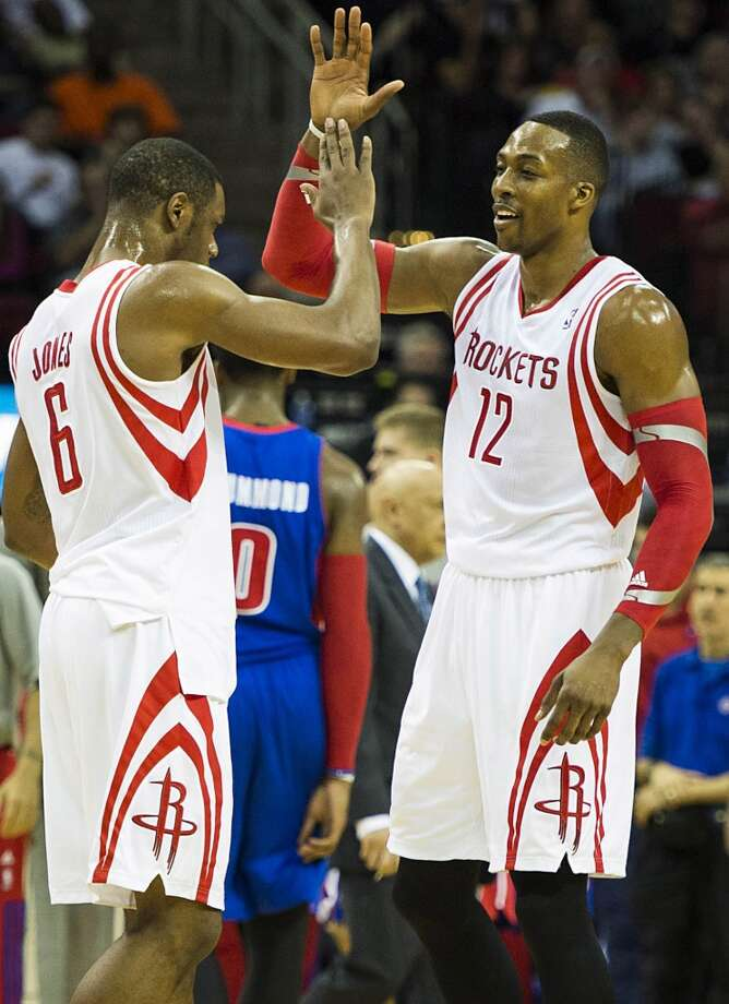 Rockets center Dwight Howard (12) celebrates with power forward Terrence Jones (6) during the first half. Photo: Smiley N. Pool, Houston Chronicle