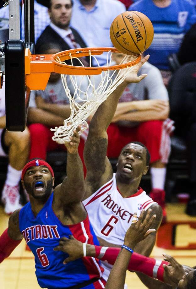 Rockets power forward Terrence Jones goes up for a tip against Pistons small forward Josh Smith during the first half. Photo: Smiley N. Pool, Houston Chronicle