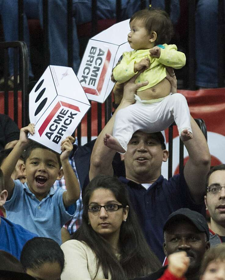 Rockets fans try to distract a Pistons free-throw shooter during the second half. Photo: Smiley N. Pool, Houston Chronicle
