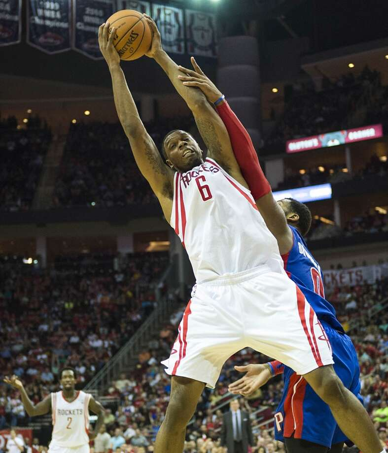 Rockets power forward Terrence Jones grabs a rebound away from Pistons center Andre Drummond. Photo: Smiley N. Pool, Houston Chronicle