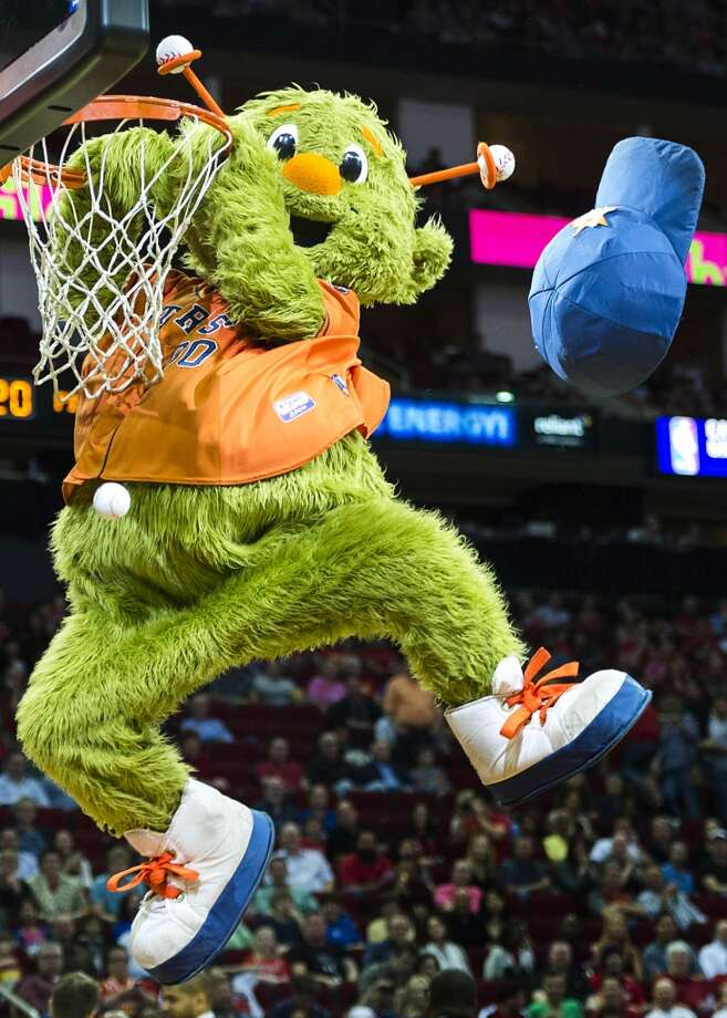 Astros mascot Orbit dunks a baseball as mascots perform during a time out during the first half. Photo: Smiley N. Pool, Houston Chronicle