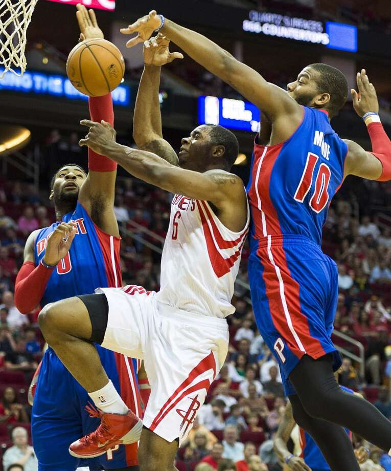 Rockets power forward Terrence Jones has the ball knocked away by Pistons power forward Greg Monroe. Photo: Smiley N. Pool, Houston Chronicle