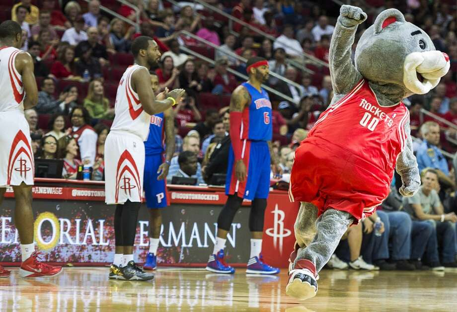 "Clutch runs onto the court to announce that the game marks the mascot's ""19th birthday"" during the first half. Photo: Smiley N. Pool, Houston Chronicle"