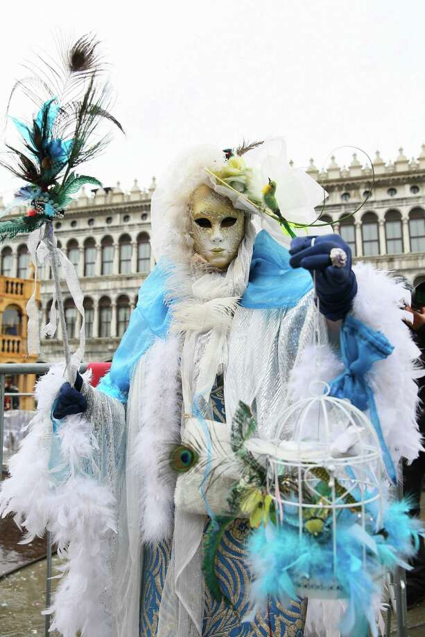 VENICE, ITALY - MARCH 02:  A man dressed in carnival costume takes part in the Venice Carnival at San Marco square in Venice, Italy, on March 2, 2014. The Venice Carnival 2014 runs from February 15 to March 4. Photo: Anadolu Agency, Getty Images / 2014 Anadolu Agency