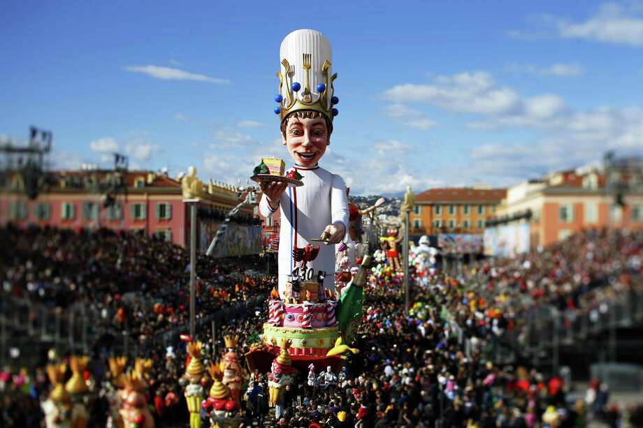 "The ""King"" float parades during the Nice Carnival on March 2, 2014 in Nice, southeastern France. The theme of this year's carnival, running from February 14 until March 4, 2014, is the ""King of Gastronomy"". (Picture taken with tilt and shift lens).    AFP PHOTO / VALERY HACHE Photo: VALERY HACHE, Getty Images / 2014 AFP"