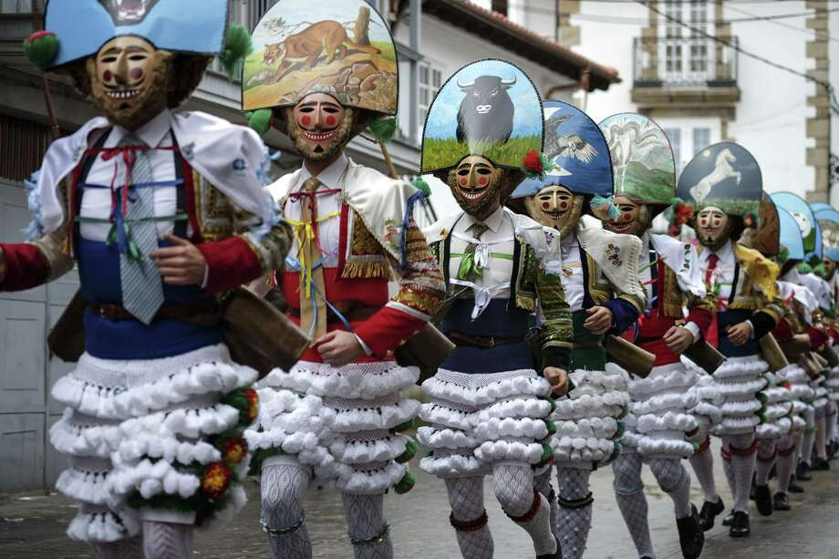 The 'Peliqueiros' or hairdressers take part in the 'Entroido' carnival festival in Laza, near Ourense, northwestern Spain, on March 2, 2014.   AFP PHOTO/ PEDRO ARMESTRE Photo: PEDRO ARMESTRE, Getty Images / 2014 AFP