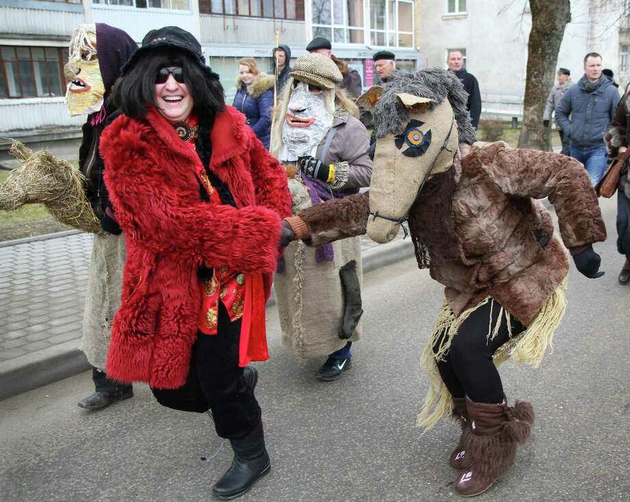 "Costumed people celebrate the ""Shrovetide"" carnival in Trakai, near Vilnius, Lithuania, on March 2, 2014. Shrovetide is a traditional Lithuanian holiday marking the end of winter.  AFP PHOTO / PETRAS MALUKAS Photo: PETRAS MALUKAS, Getty Images / 2014 AFP"