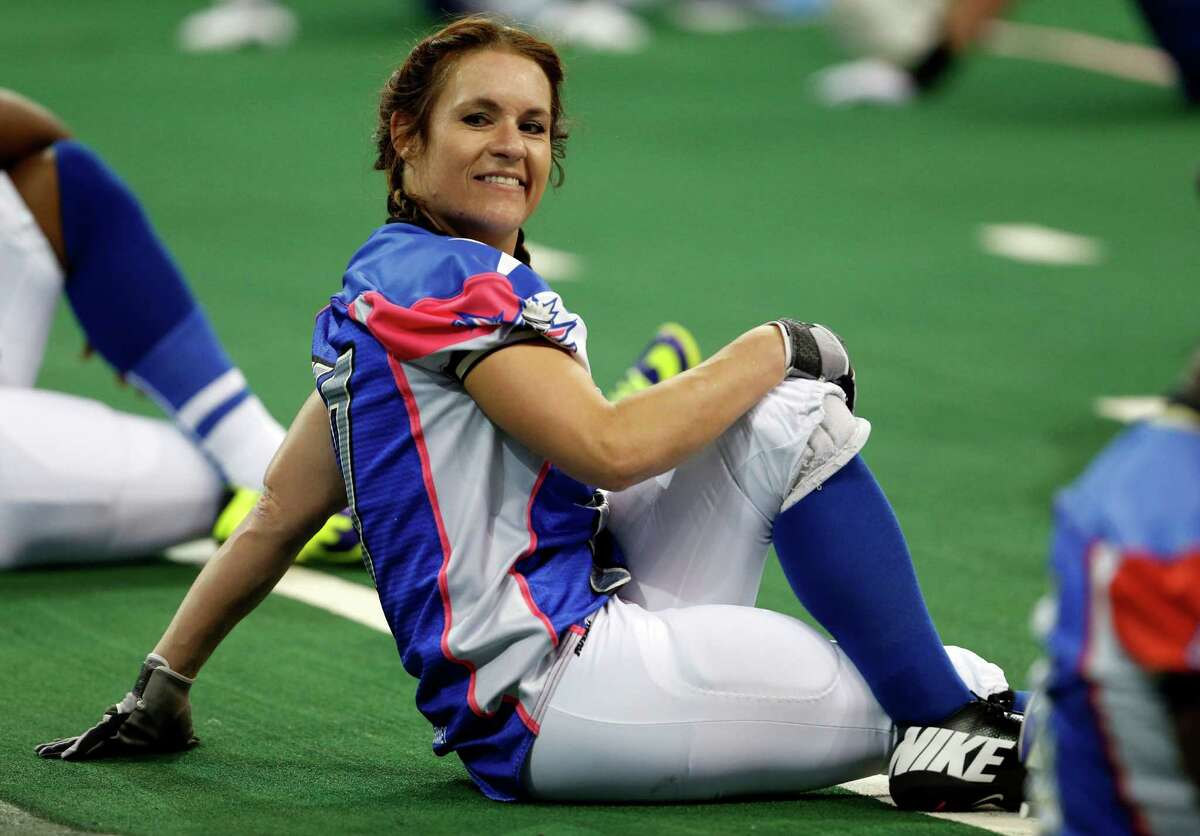 Texas Revolution's Jennifer Welter warms up for the Revolution's Indoor Football League game against the North Texas Crunch on Saturday, Feb. 15, 2014, in Allen, Texas. Welter became what is believed to be the first woman who wasn't a kicker or holder to play in a men's pro football game. The 5-foot-2, 130-pound resident of North Texas was thrown for a 1-yard loss on her first carry as a running back. (AP Photo/The Dallas Morning News, Vernon Bryant) MANDATORY CREDIT; MAGS OUT; TV OUT; INTERNET USE BY AP MEMBERS ONLY; NO SALES