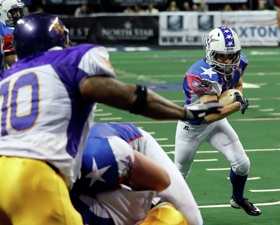 Texas Revolution's Jennifer Welter (47) runs up the field as the North Texas Crunch defense closes in on her near the goal line during the second half of an Indoor Football League game Saturday, Feb. 15, 2014, in Allen, Texas. (AP Photo/The Dallas Morning News, Vernon Bryant) MANDATORY CREDIT; MAGS OUT; TV OUT; INTERNET USE BY AP MEMBERS ONLY; NO SALES Photo: Vernon Bryant, Associated Press / TThe Dallas Morning News