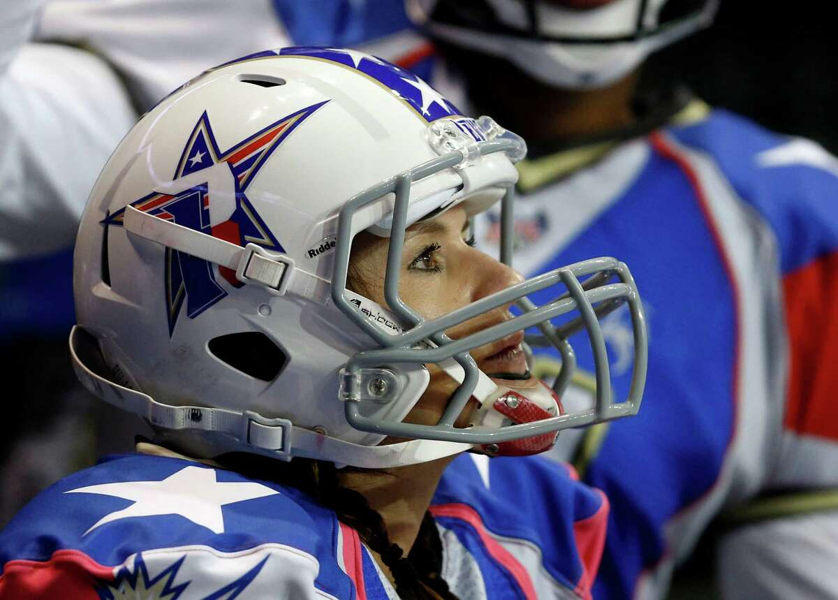 Texas Revolution's Jennifer Welter watches the team's Indoor Football League game against the North Texas Crunch on (Saturday, Feb. 15, 2014, in Allen, Texas. Welter became what is believed to be the first woman who wasn't a kicker or holder to play in a men's pro football game. The 5-foot-2, 130-pound resident of North Texas was thrown for a 1-yard loss on her first carry as a running back (AP Photo/The Dallas Morning News, Vernon Bryant) MANDATORY CREDIT; MAGS OUT; TV OUT; INTERNET USE BY AP MEMBERS ONLY; NO SALES