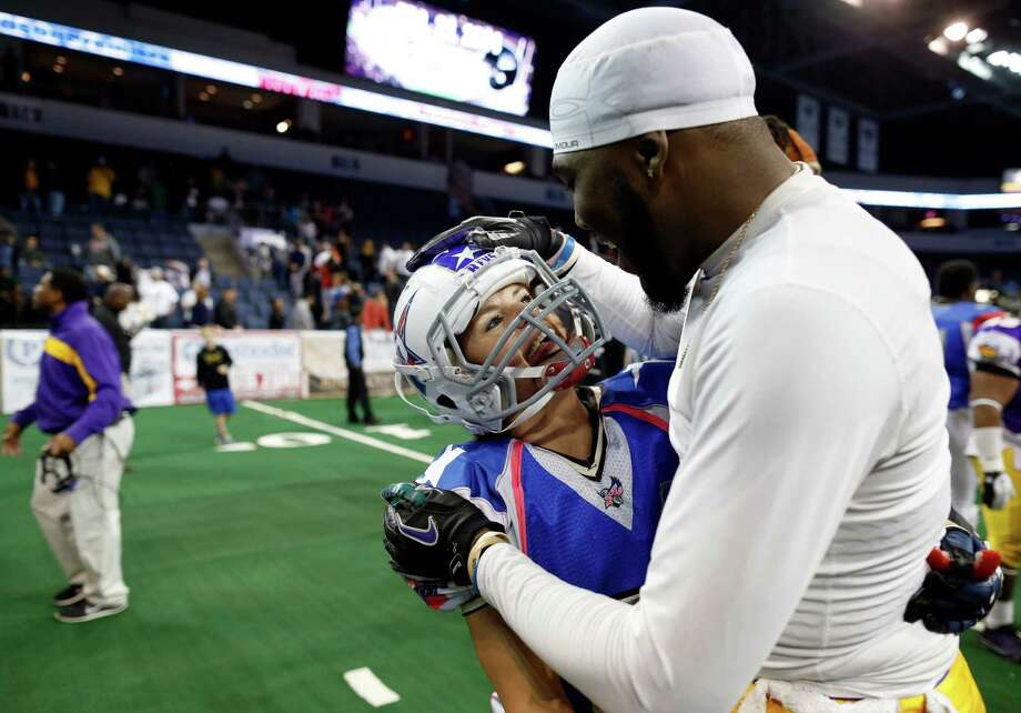 Texas Revolution's Jennifer Welter (47) is complimented by North Texas Crunch defender Cedric Hearvey after a preseason Indoor Football League game (Saturday, Feb. 15, 2014, in Allen, Texas. Hearvey tackled Welter, a running back, on her third carry of the game, in the fourth quarter. (AP Photo/The Dallas Morning News, Vernon Bryant) MANDATORY CREDIT; MAGS OUT; TV OUT; INTERNET USE BY AP MEMBERS ONLY; NO SALES Photo: Vernon Bryant, Associated Press / TThe Dallas Morning News