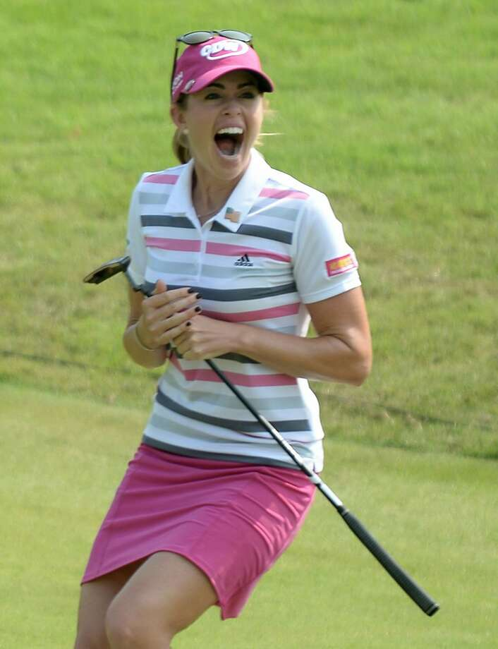 Paula Creamer surprises herself by making a 75-foot eagle putt to win her first LPGA title in nearly four years. Creamer, who grew up in Pleasanton, hadn't won since the 2010 U.S. Women's Open. Photo: Roslan Rahman, AFP/Getty Images