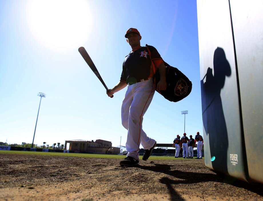 Catcher Max Stassi walks out of the wagon gate in the outfield to stretch at the Osceola County Stadium before the game. Photo: Karen Warren, Houston Chronicle