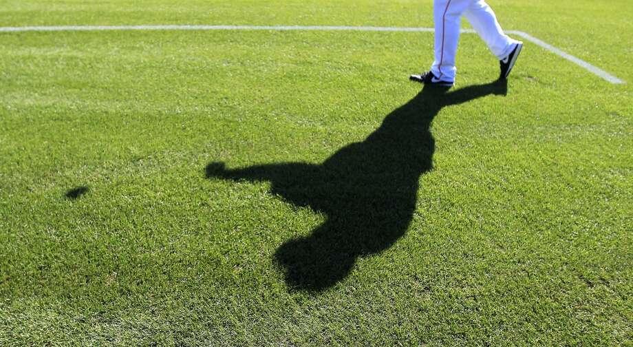 Jeff Murphy, catching coach, Triple A Oklahoma City throws catch at the Osceola County Stadium. Photo: Karen Warren, Houston Chronicle