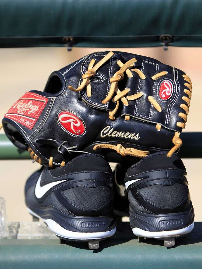Paul Clemens's gloves and shoes at the Osceola County Stadium before the game. Photo: Karen Warren, Houston Chronicle