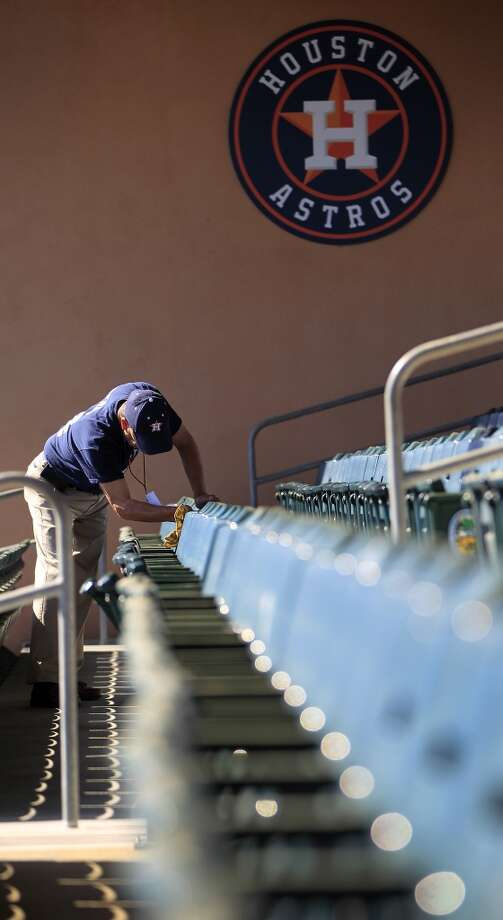 Jim Vigil cleans the seats at the Osceola County Stadium, in preparation for the home opener against the Braves on Sunday. Photo: Karen Warren, Houston Chronicle